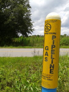 A marker for a buried natural gas pipeline. Image: theconversation.com