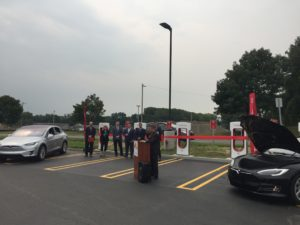 John Cole, owner of Cole's Collision Center speaks to the attendees at the ribbon cutting ceremony in celebrations of the installation of 20 TESLA Supercharger stations at the Crossgates Mall in Guilderland, NY.