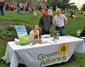 Green Alliance table in Portsmouth, NH at the 2017 Earth Day Party. Pictured (L-R): GA intern Diana Sarni, GA Co-owner Chad Butson (middle) and GA loyalty card holder on the right. Photo: Green Alliance