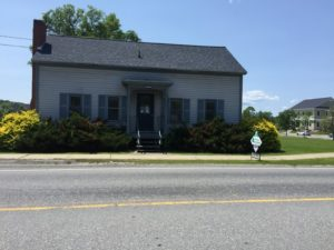 Old Hinesburg police station before transformation into Energy Futures Group building.