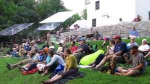 A gathering at the solar stage in downtown Warner, New Hampshire. Photo courtesy of Neil Nevins.