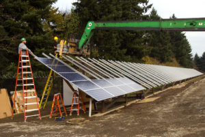 Installing solar panels. Photo: Oregon Department of Transportation.