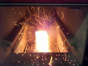 Wood chip stove fire box. Public domain.