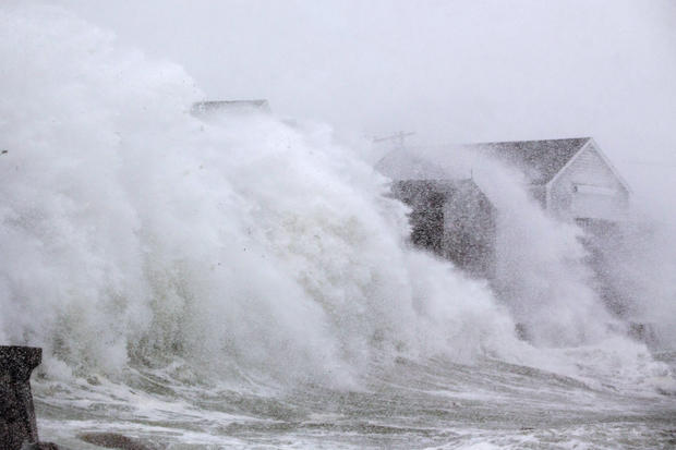 Wave crashing over a home in Scituate, Massachusetts  (Photo: Scott Eisen | Getty Images)