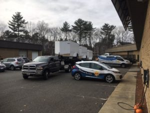 Three enclosed trailers that will be converted into Solar Outreach Systems once all materials arrive at ReVision Energy's decarbonization facility in North Andover, MA