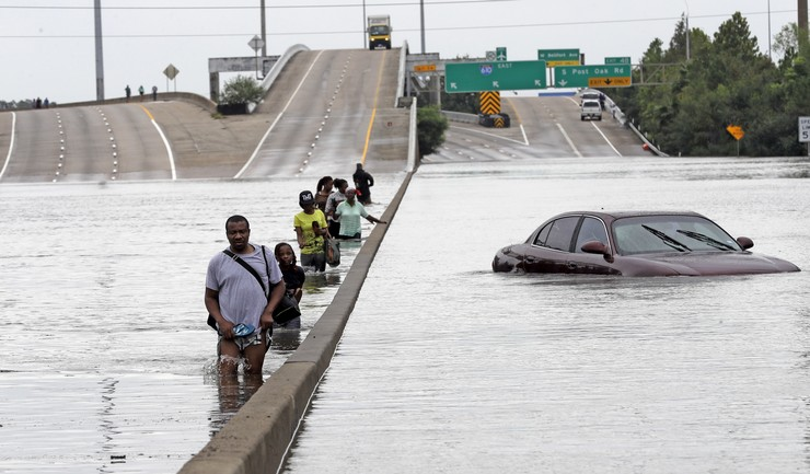 Evacuees wade down a flooded section of Interstate 610 as floodwaters from tropical storm Harvey rise Aug. 27, 2017, in Houston. Credit: AP Photo/David J. Phillip