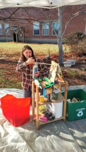 Paige Heverly practices using spray foam insulation at a Sustainable Woodstock DIY interactive weatherization station
