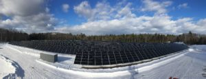 With the Ossipee Mountains in the background, the state's largest solar array is making energy at Moultonborough Neck where the New Hampshire Electric Co-Op has finalized the construction of a two-megawatt system. (John Koziol)
