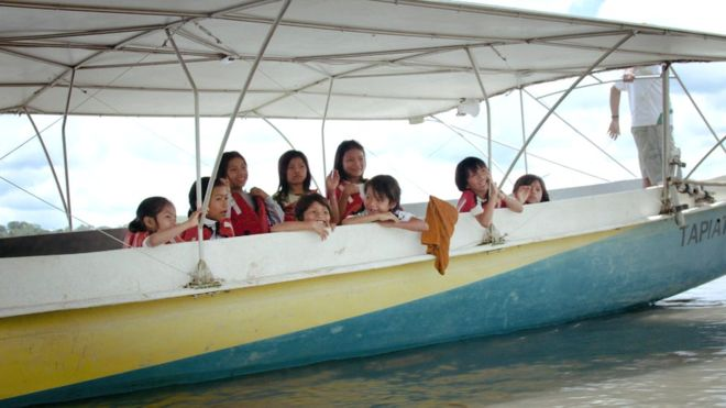 Commuting to school in a solar-powered canoe