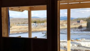 The view from the interior framework of the Floersch home in Berlin, VT with the solar field in the distance. Credit: Larry Floersch.