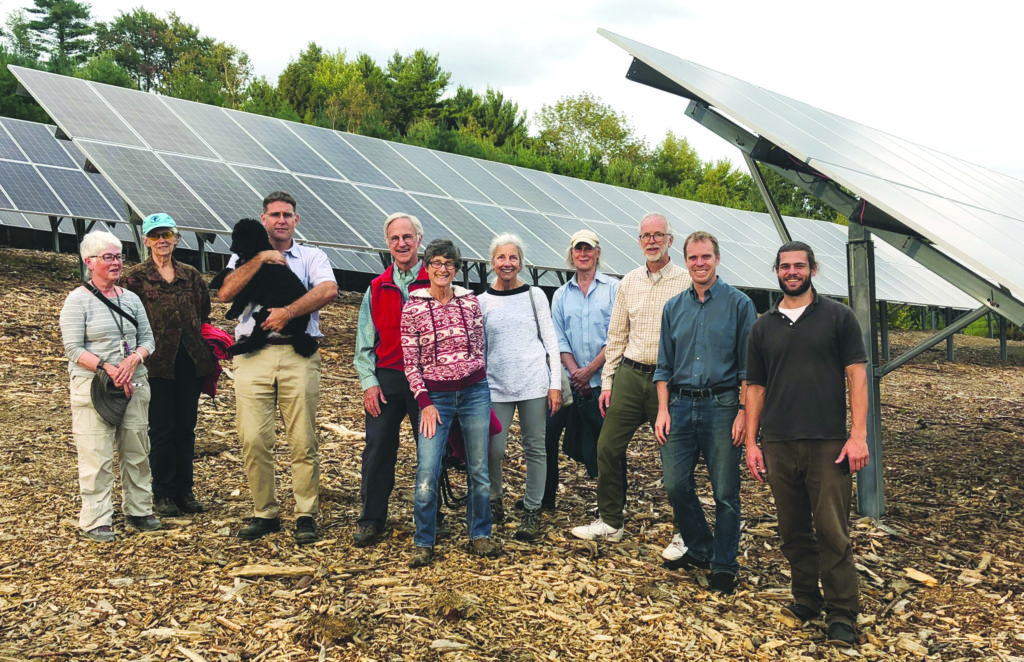 Owners on tour of their photovoltaic system and guests.